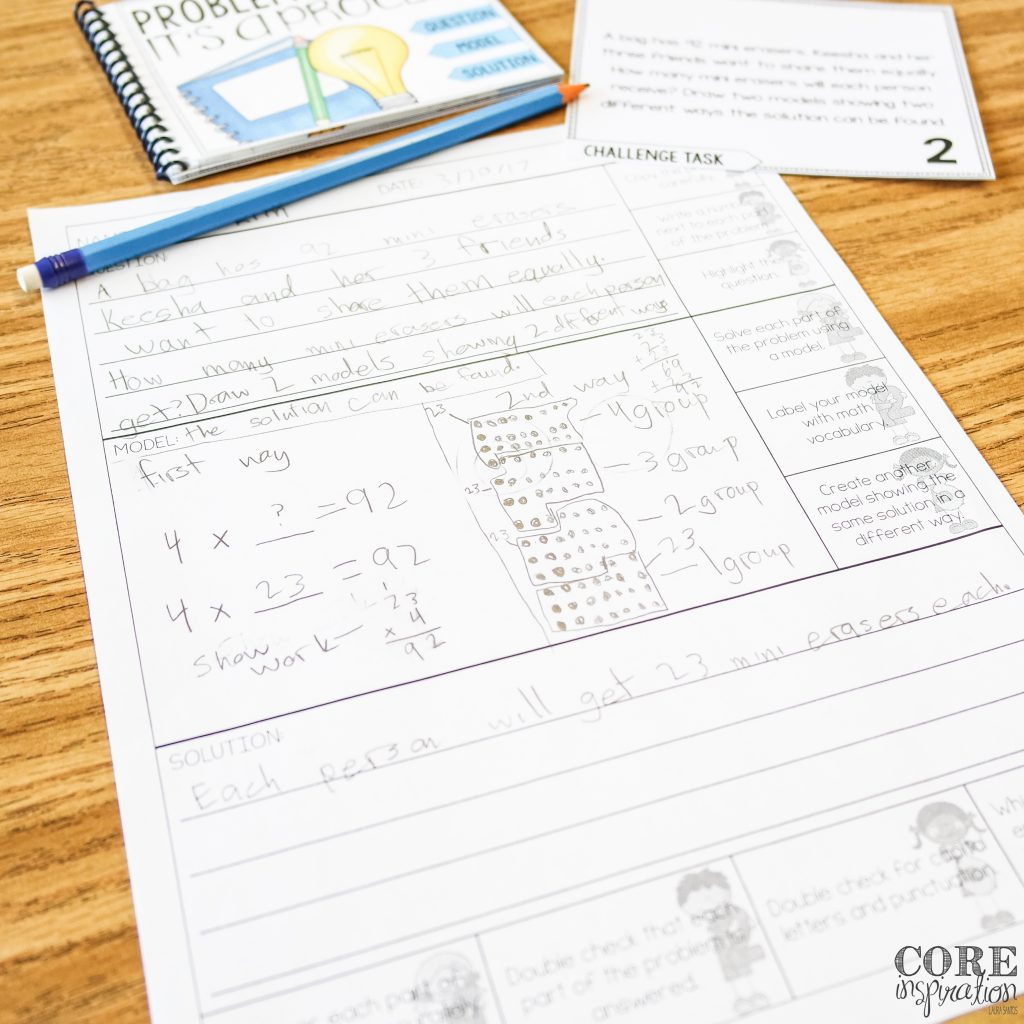 Third grade problem solving task card and recording sheet on student desk.