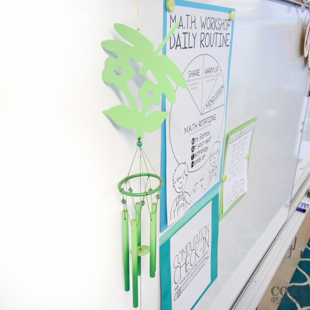 Hnaing green wind chimes that can be rung by the teacher to bring students to attention.