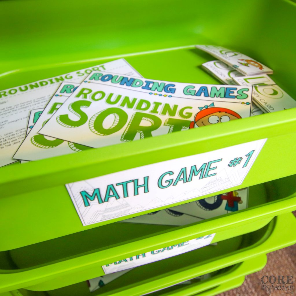 Math game instruction cards arranged in green storage drawers