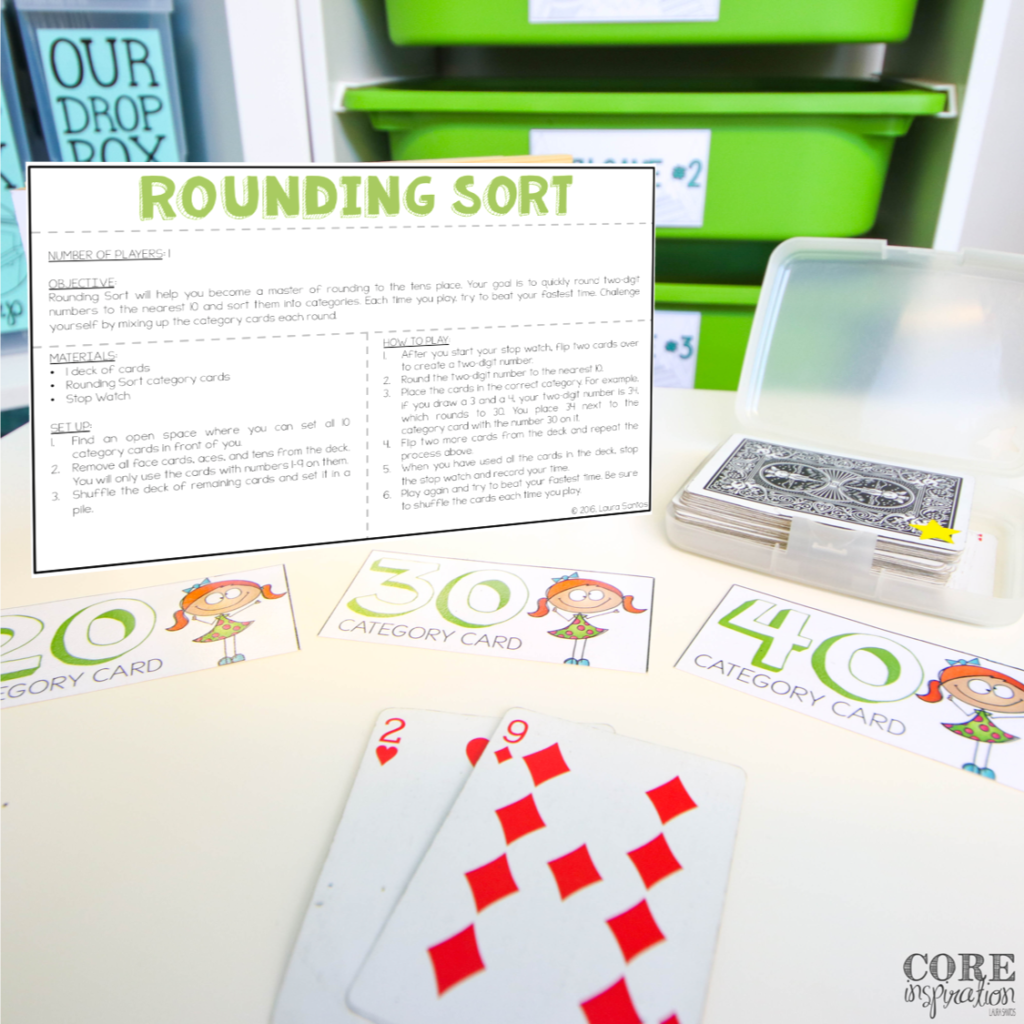 Rounding sort math in motion game card with instructions on display and materials arranged for math game play