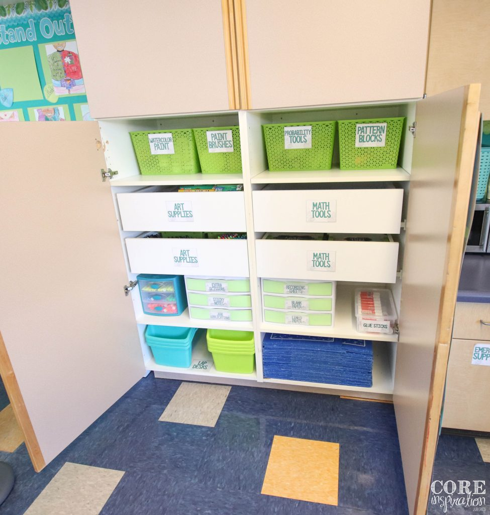 Student supply cabinet in classroom open and organized with bins, drawers, and labels