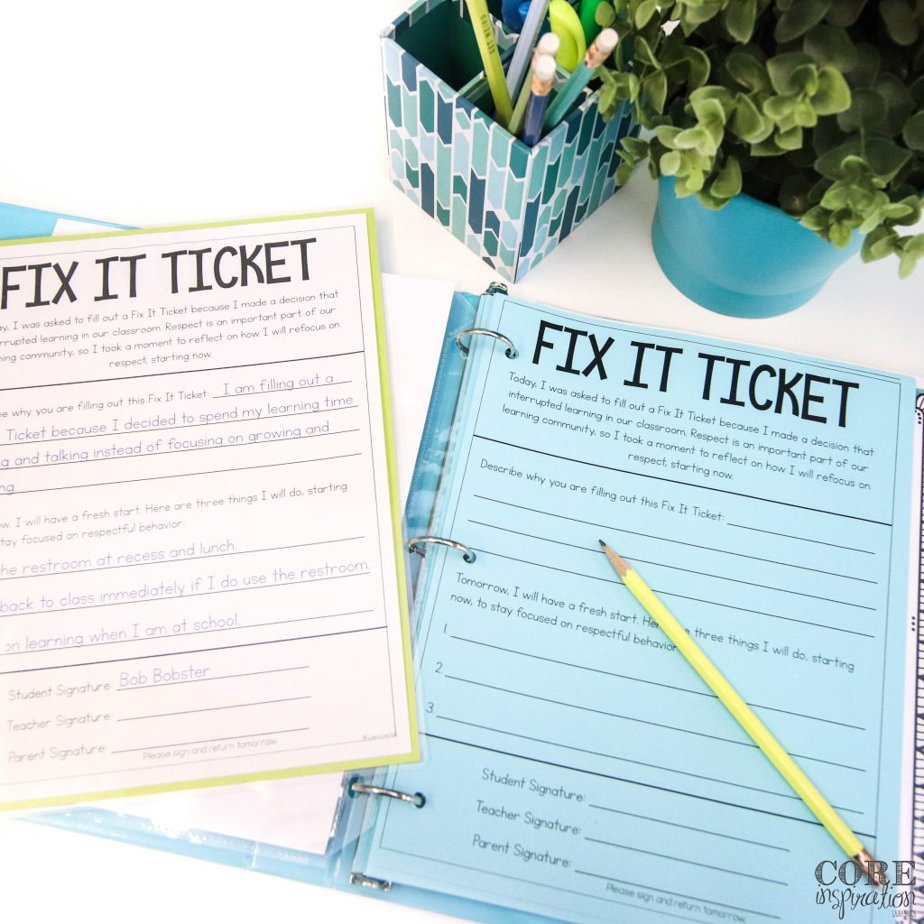 Core Inspiration Fix It Ticket sitting in blue binder on desk with the fix it ticket routine sheet and example laying next to it. Providing students with an example of how the fix it ticket should be complete helps them reflect more independently.