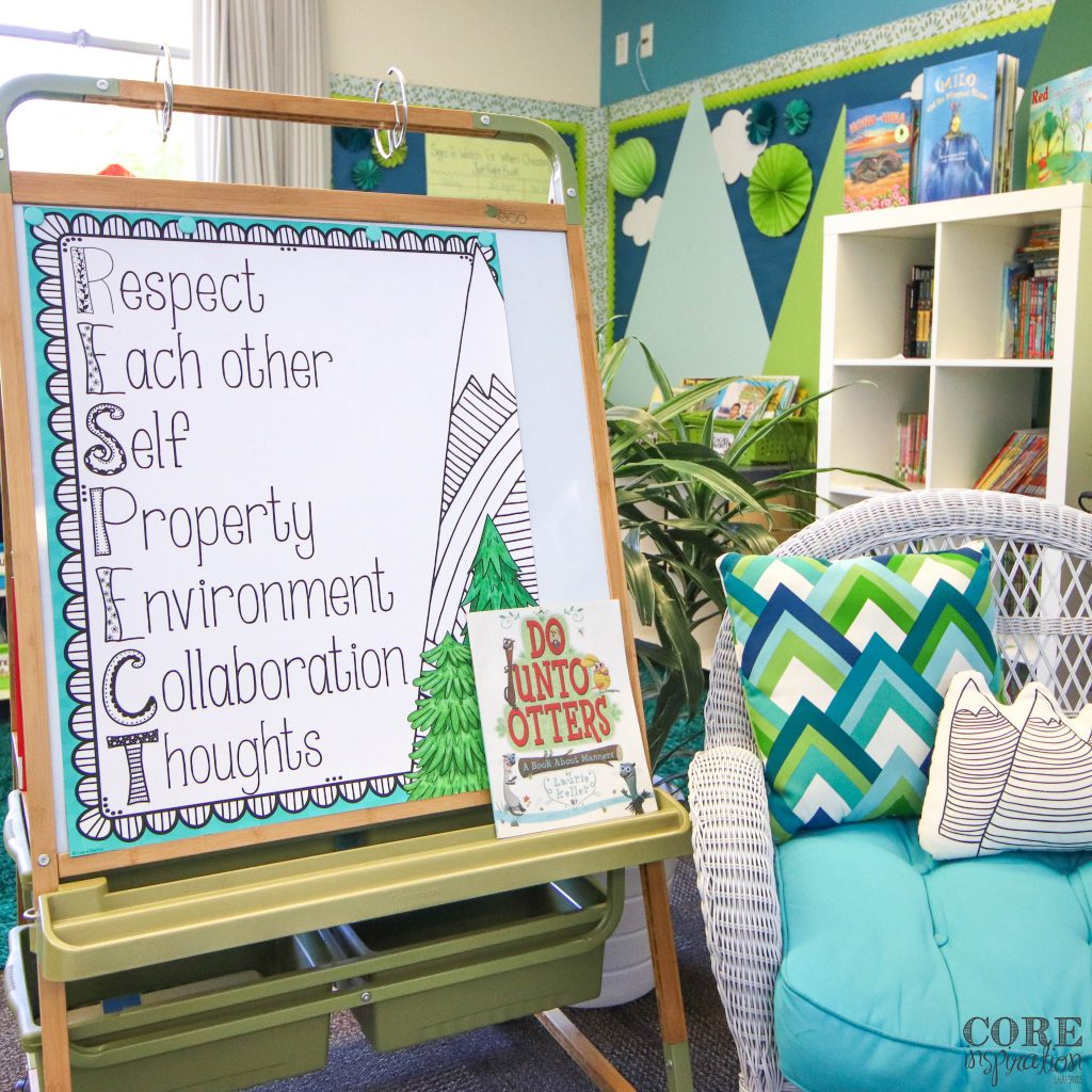 Core Inspiration R.E.S.P.E.C.T. poster on an easel next to the classroom library with a window in the background. The book Do Unto Otters by Laurie Keller sitting on the tray of easel ready for the first lesson on the meaning of respect in the classroom.