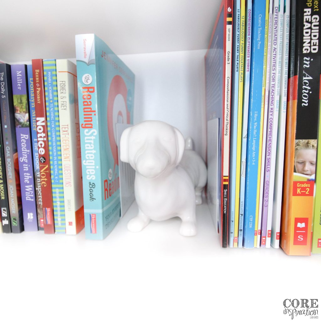 Teacher reference books organized on closet shelf by subject area for easy access.