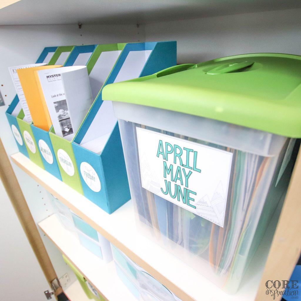 Monthly art project bin on classroom shelf next to day of the week bins to help teachers stay organized.