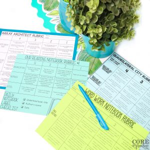 Rubrics for various projects scattered on table top with highlighter laying on top of them.
