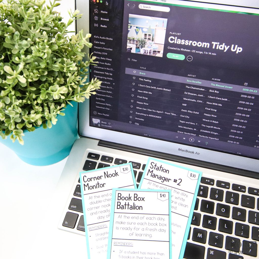 Core Inspiration Classroom Job cards laying on top of laptop keyboard with tidy up time Spotify playlist in background