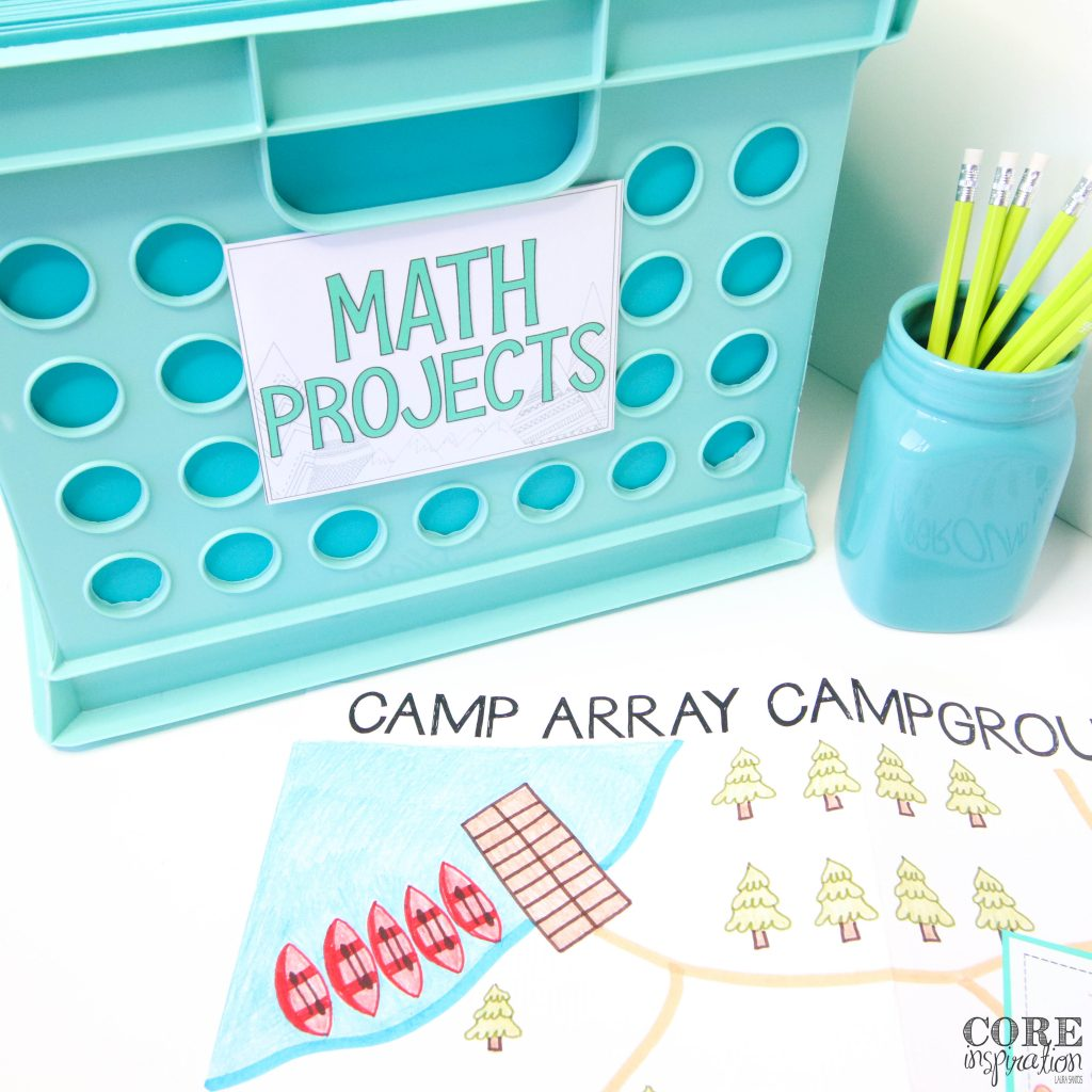 """Camp Array Multiplication Math Project map maying on a table next to an aqua file bin that is labeled """"math projects"""""""